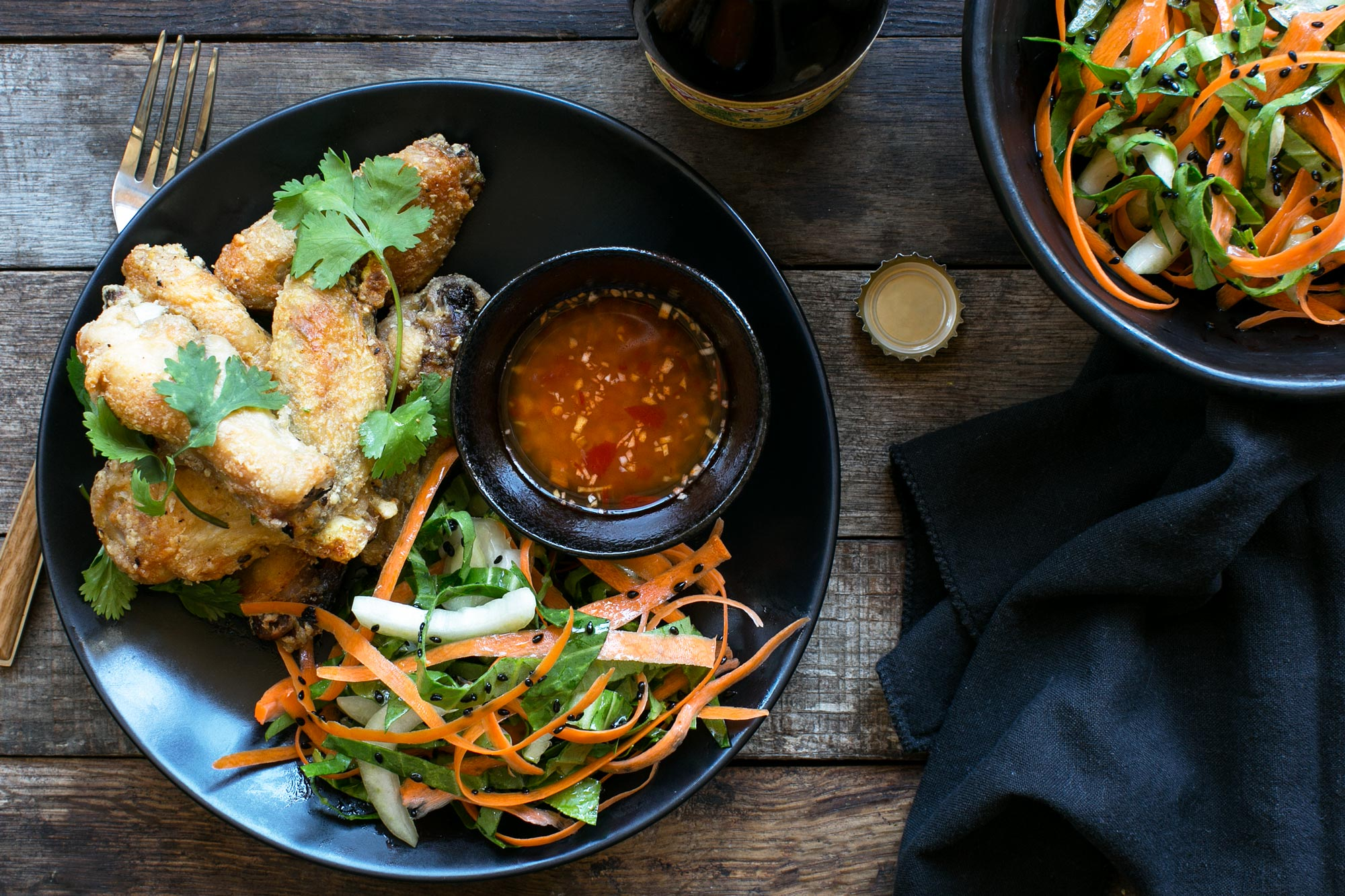 chicken-wings-with-spicy-ginger-sauce-and-bok-choy-black-sesame-slaw